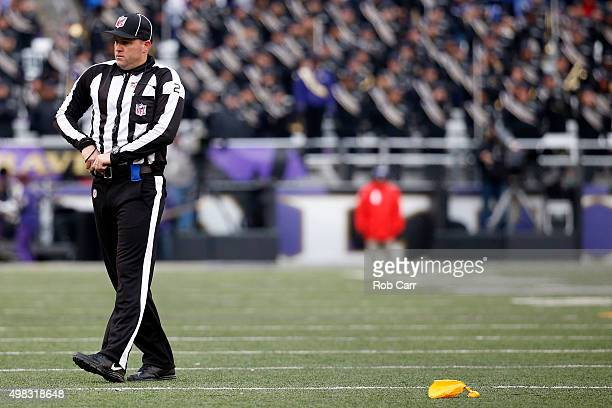 Line Judge Bart Longson walks across the field after a flag was thrown in the fourth quarter of a game between the St Louis Rams and the Baltimore...