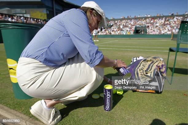 A Line Judge counts out the new balls to put into a slazenger canister