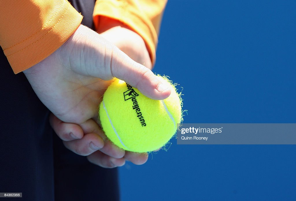 A line judge holds an Australian Open tennis ball during the first round match against John Isner of the United States of America and Dominik Hrbaty of Slovakia during day one of the 2009 Australian Open at Melbourne Park on January 19, 2009 in Melbourne, Australia.