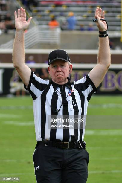Line Judge Jeffrey Cooney signals a touchdown during a game between the Temple Owls and the East Carolina Pirates at DowdyFicklen Stadium in...
