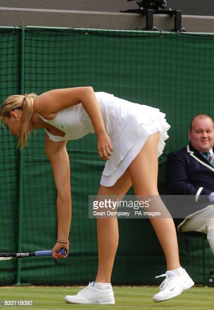 A Line Judge looks on as Russia's Maria Sharapova retrieves the ball during her match against Chinese Taipei's YungJan Chan during The All England...