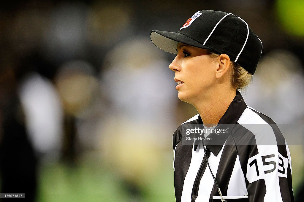 Line judge Sarah Thomas, takes the field for a preseason game between the Oakland Raiders and the New Orleans Saints at the Mercedes-Benz Superdome on August 16, 2013 in New Orleans, Louisiana. The Saints won 28-20.