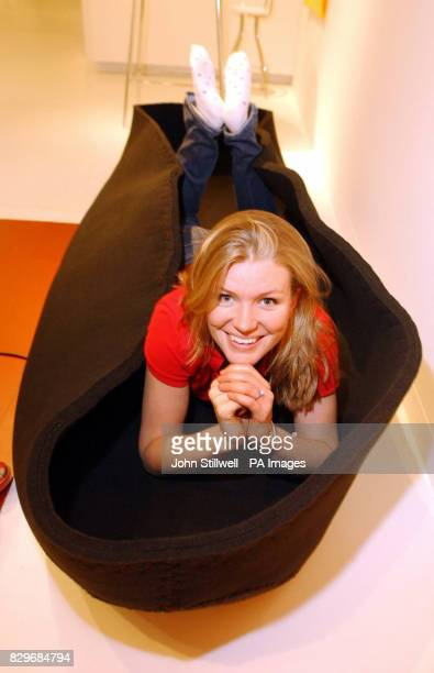 Line Lund the designer of the 'Touch me' Exhibition relaxes in the hug me sofa made of industrial felt which visitors can wrap around them as a...