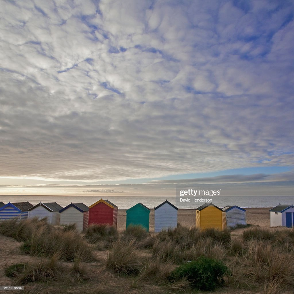 Line of beach huts in dunes : Stock Photo