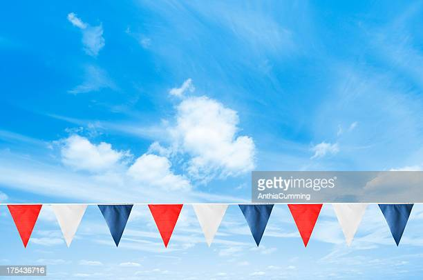 A line of British bunting hanging in the blue sky