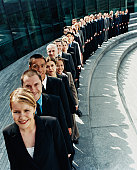 Line of Business People Waiting Outdoors on a Step