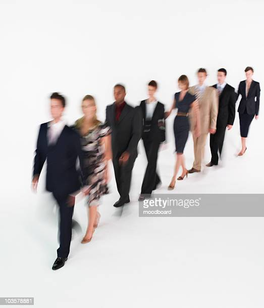 Line of businesspeople walking, blurred effect