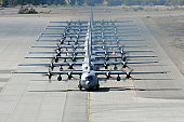 November 18, 2009 - A line of C-130 Hercules taxi during a Mobility Air Forces Exercise at Nellis Air Force Base, Nevada.