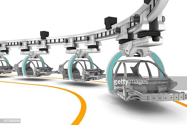 Line of cars being built on a white background