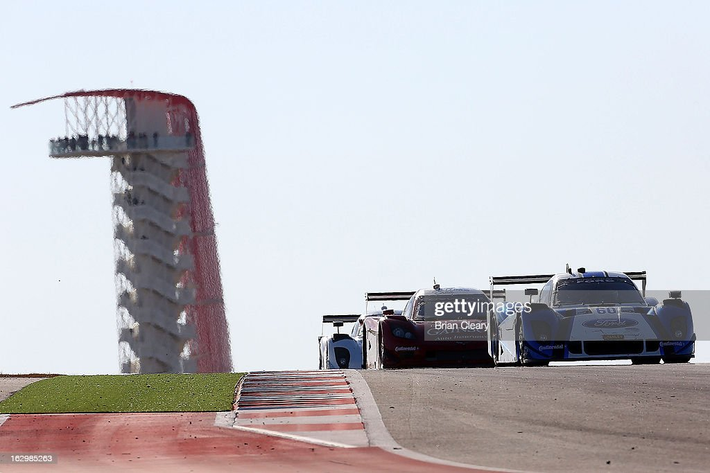 A line of cars crests a hill at the Grand-Am of the Americas at Circuit of The Americas on March 2, 2013 in Austin, Texas.