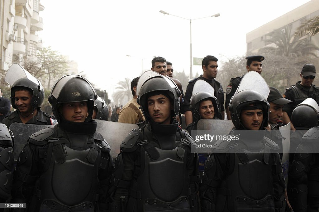 A line of Egyptian riot police stand in formation during a demonstration at the headquarters of the Muslim Brotherhood on March 22, 2013 in Cairo, Egypt. Opposition demonstrators converged on the headquarters of the Muslim Brotherhood in the Cairo suburb of Muqattam to protest against the government of President Mohammed Morsi, who is closely connected to the Muslim Brotherhood movement.