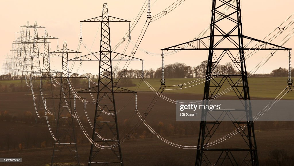 A line of electricity pylons crosses the Essex countryside on November 19, 2009 near Cambridge, United Kingdom. As world leaders prepare to gather for the Copenhagen Climate Summit in December, the resolve of the industrial nations seems to be weakening with President Obama stating that it would be impossible to reach a binding deal at the summit. Climate campaigners are concerned that this disappointing announcement is a backward step ahead of the summit.
