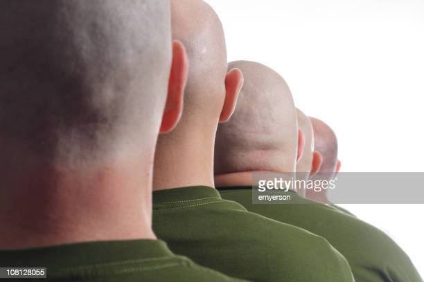 Line of Male Soldiers with Shaved Heads