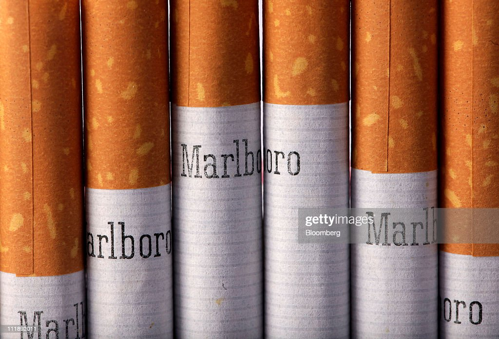 A line of Marlboro cigarettes, produced by Altria Group Inc., sit arranged for a photograph in London, U.K., on Thursday, April 7, 2011. The global market for cigarettes excluding China, which is largely closed to foreign tobacco companies, will probably shrink by 2.5 percent in 2011, BAT Chief Executive Officer Nicandro Durante said Feb. 24. Photographer: Jason Alden/Bloomberg via Getty Images