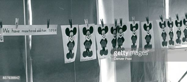 Line of Mickey Mouse Drawings Indicates who has mastered Adding 7 9 and 10S The drawing were colored by youngsters in Mrs Thora McClure's firstgrade...