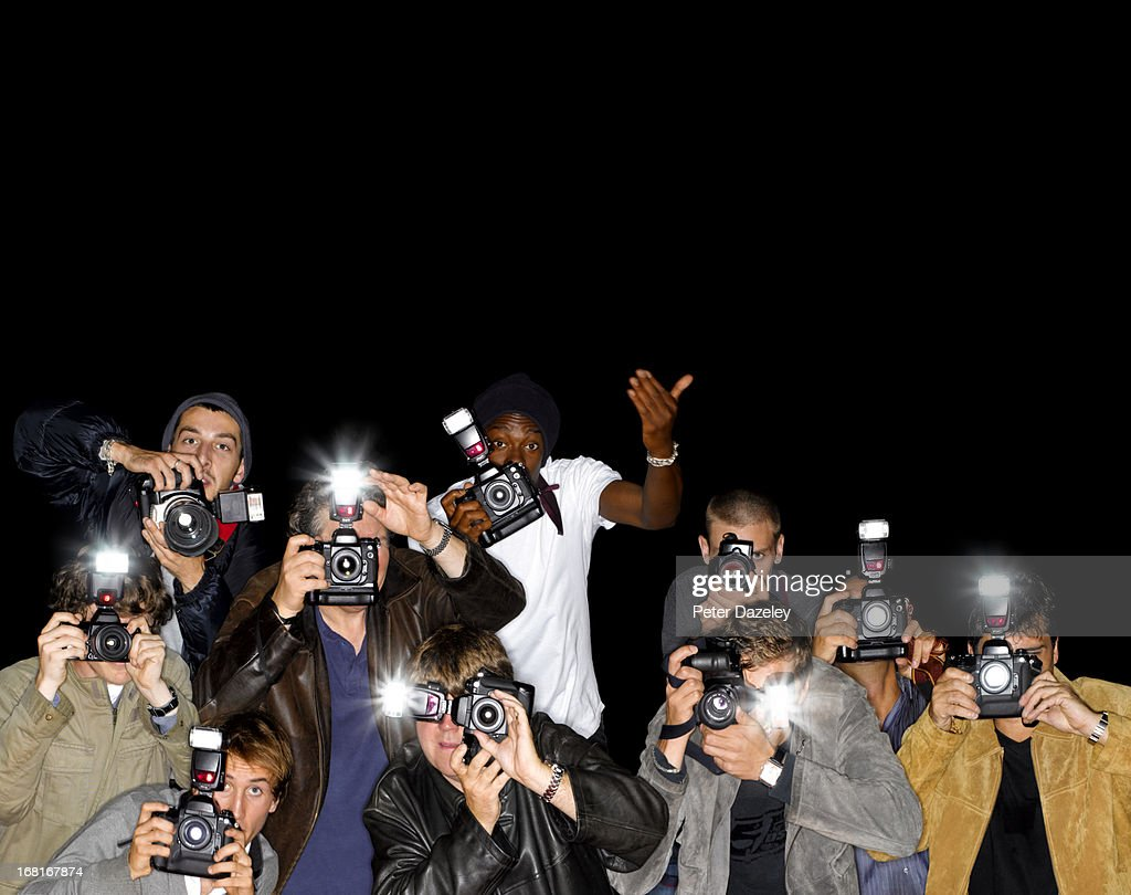 Line of paparazzi photographers with copy space : Stock Photo