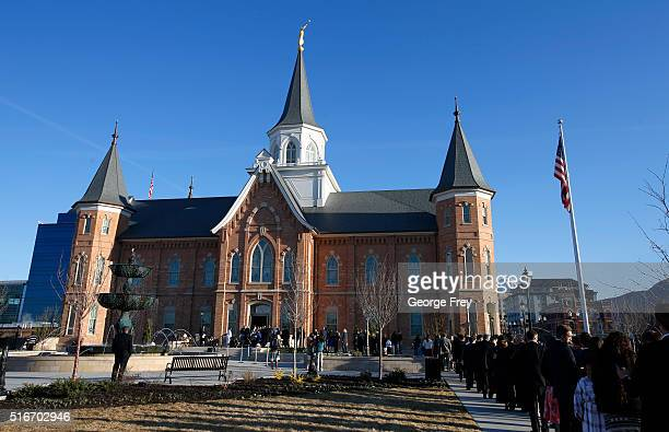 A line of people wait outside the Provo City Center Temple of the Church of Jesus Christ of Latter Day Saints to attend the dedication on March 20...