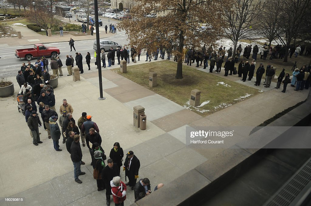 A line of people wait to enter the Legislative Office Building continues to grow as hundreds hope to attend a hearing on gun control in Hartford, Connecticut, Monday, January 28, 2013.