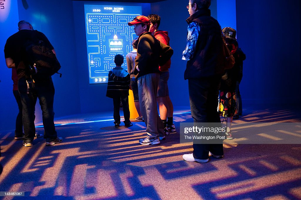 A line of people wait to play Pac-Man at the exhibit. The Art of Video Games is an exhibit at the American Art Museum thru September 30, 2012.