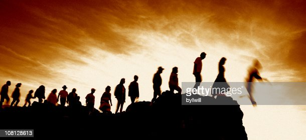 Line of People Walking Single File Off Cliff