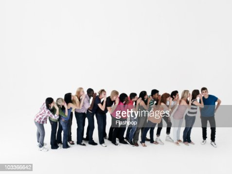 Line of people whispering into each others ears : Stock Photo