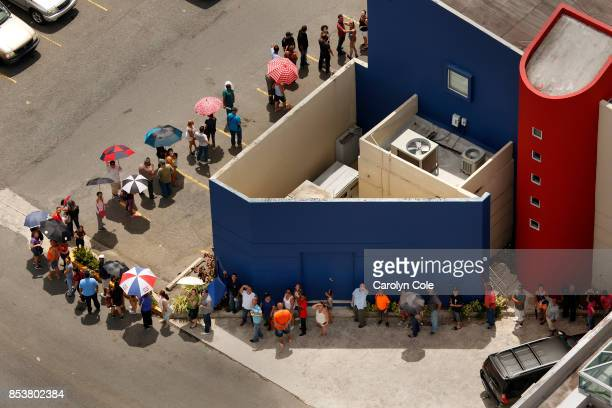 A line of people wraps aroung the Banco Popular in San Juan as people are desperate to get cash Nearly one week after hurricane Maria devastated the...