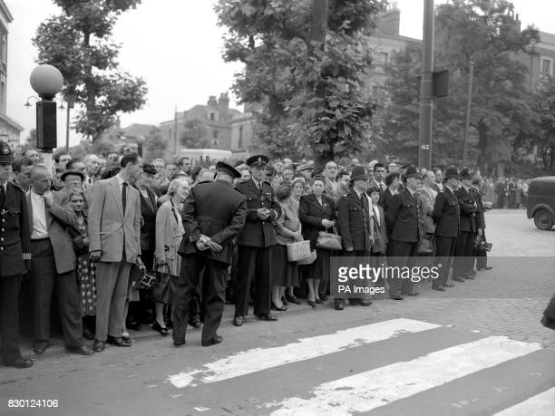 A line of police keeps the crowd from approaching the gates of Holloway Prison in London as Ruth Ellis is executed for the murder of her lover racing...