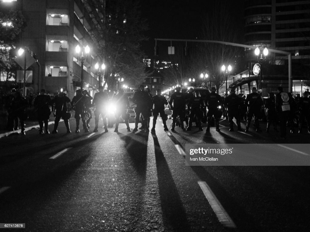 Line of police officers in riot gear : Stock Photo