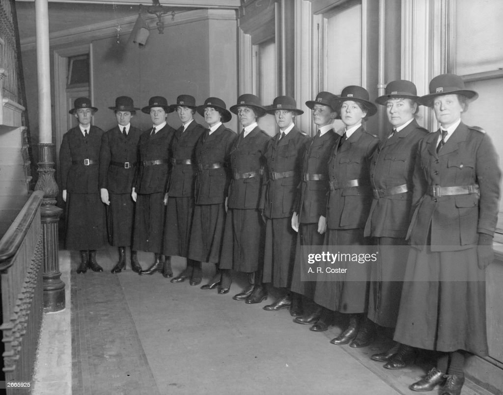 A line of policewomen newly recruited for duty at munition works.