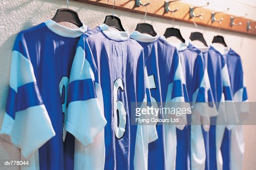 Line Of Rugby Shirts Hanging From Clothes Rail