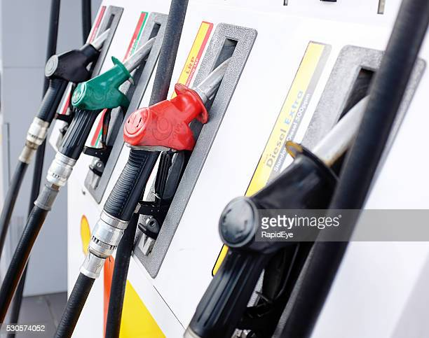 Line of Shell gas pumps at suburban filling station