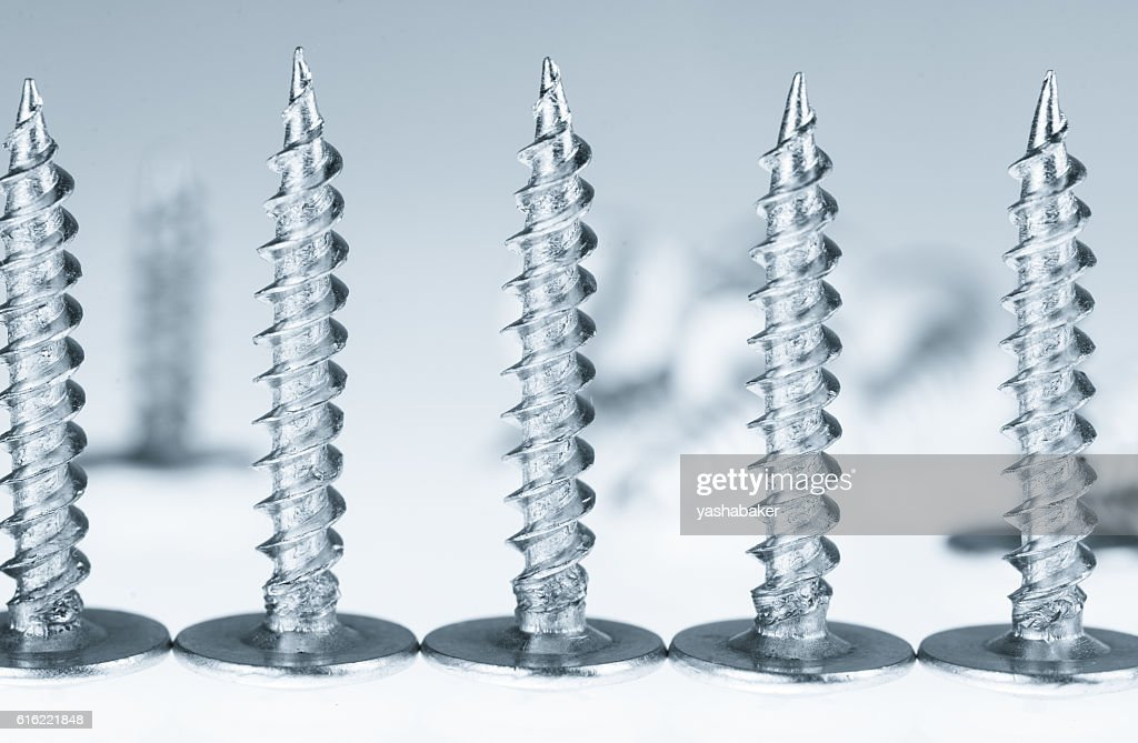 Line of silver screws toned grey : Foto stock