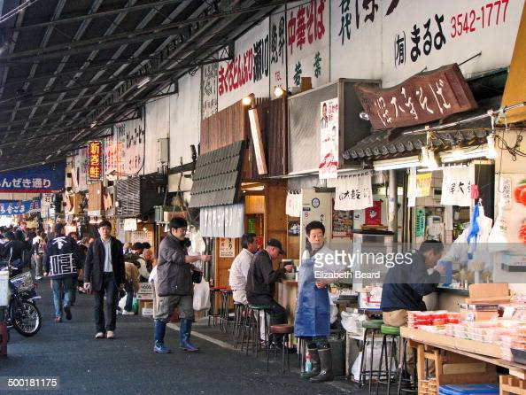 CONTENT] A line of soup stalls in the Tsukiji Outer Market