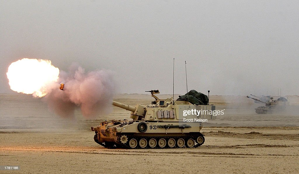 A line of US Army Paladin M109A6 155mm selfpropelled Howitzer fires during live fire exercises February 13 2003 in near the Iraqi border in northern...