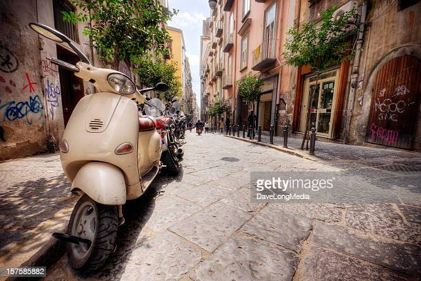 Line of Vespas on an Italian street in the summer