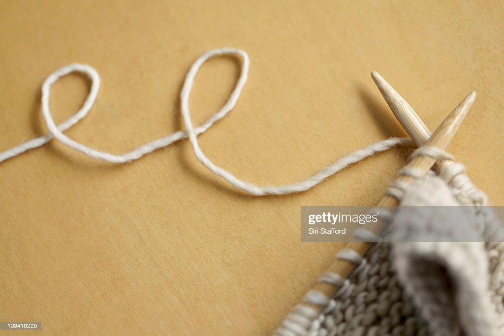 line of wool string connected to knitting project