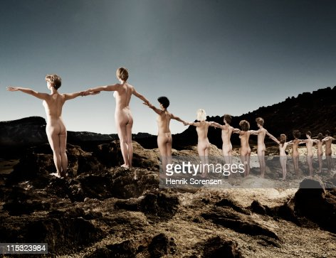 line of young naked people in the mountains : Photo