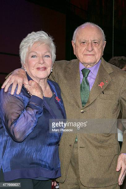 Line Renaud and Pierre Berge attend the 'Sidaction 20th Anniversary' at Musee du Quai Branly on March 10 2014 in Paris France