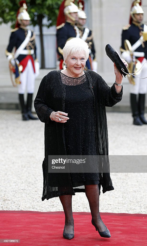 <a gi-track='captionPersonalityLinkClicked' href=/galleries/search?phrase=Line+Renaud&family=editorial&specificpeople=220398 ng-click='$event.stopPropagation()'>Line Renaud</a> arrives at the Elysee Palace for a State dinner in honor of Queen Elizabeth II, hosted by French President Francois Hollande as part of a three days State visit of Queen Elizabeth II after the 70th Anniversary Of The D-Day on June 6, 2014 in Paris, France.