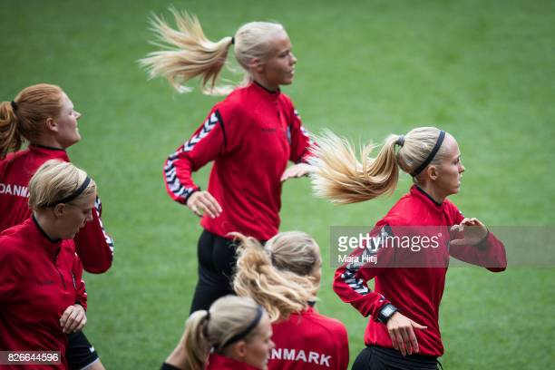 Line Roddik of Denmark and the team warms up during a training prior UEFA Women's Euro 2017 Final against Netherlands at De Grolsch Veste Stadium on...