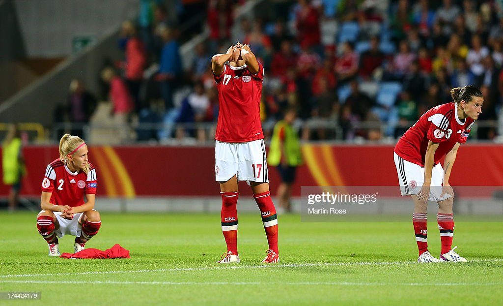 Line Roeddik, Nadia Nadim and Katrine Soendergaard Pedersen of Denmark look dejected after losing the UEFA Women's Euro 2013 semi final match between Norway and Denmark at Nya Parken on July 25, 2013 in Norrkoping, Sweden.