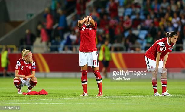 Line Roeddik Nadia Nadim and Katrine Soendergaard Pedersen of Denmark look dejected after losing the UEFA Women's Euro 2013 semi final match between...