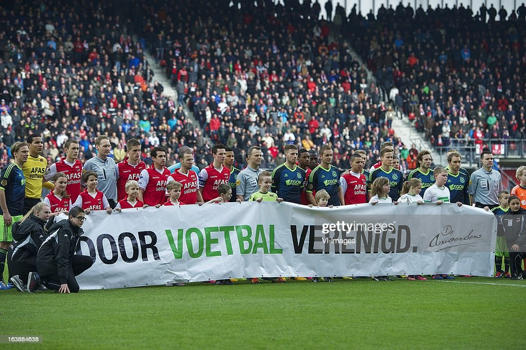 line up during the Dutch Eredivisie match between AZ Alkmaar and Ajax Amsterdam at the AFAS Stadium on march 17, 2013 in Alkmaar, The Netherlands