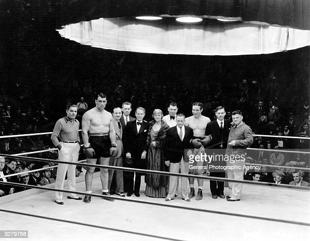 A line up of certain boxing celebrities and the cast during the MGM production of 'The Prizefighter And The Lady' From left to right Bill Duffy Primo...