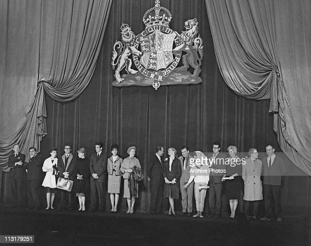 A line up of film stars on stage at the Odeon Leicester Square in London England before the Royal Film Performance in February 1961 The line up...