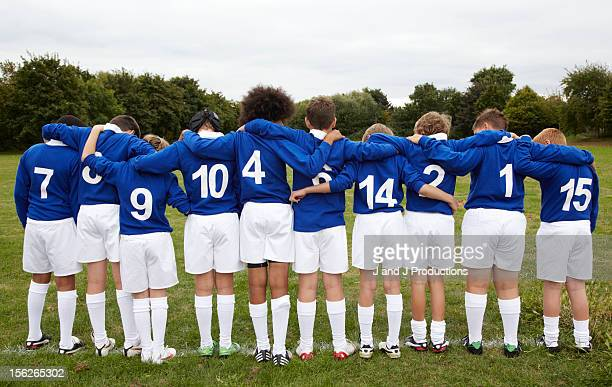 Line up of young rugby players from behind