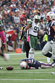 Linebackedr Calvin Pace of the New York Jets sacks Quarterback Tom Brady of the New England Patriots at Gillette Stadium on October 25 2015 in...