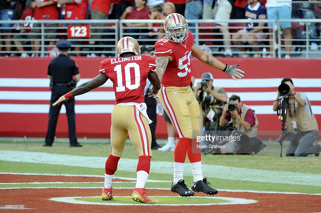 Linebacker Aaron Lynch #59 and wide receiver <a gi-track='captionPersonalityLinkClicked' href=/galleries/search?phrase=Bruce+Ellington&family=editorial&specificpeople=7405384 ng-click='$event.stopPropagation()'>Bruce Ellington</a> #10 of the San Francisco 49ers celebrate after a blocked punt against the Chicago Bears during their game at Levi's Stadium on September 14, 2014 in Santa Clara, California.