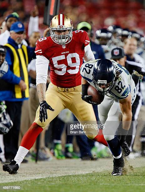 Linebacker Aaron Lynch of the San Francisco 49ers pushes down tight end Luke Willson of the Seattle Seahawks on a 15yards catch in the fourth quarter...