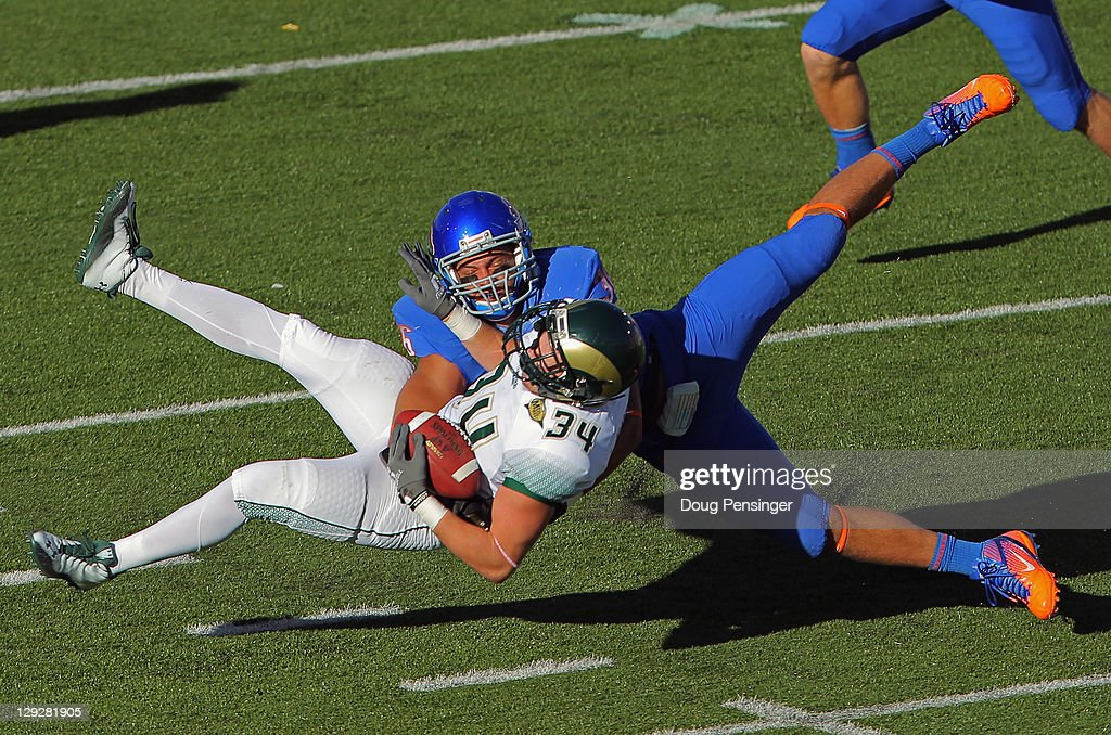 Linebacker Aaron Tevis of the Boise State Broncos breaks up a pass intended for fullback Joe Brown of the Colorado State Rams at Sonny Lubick Field...